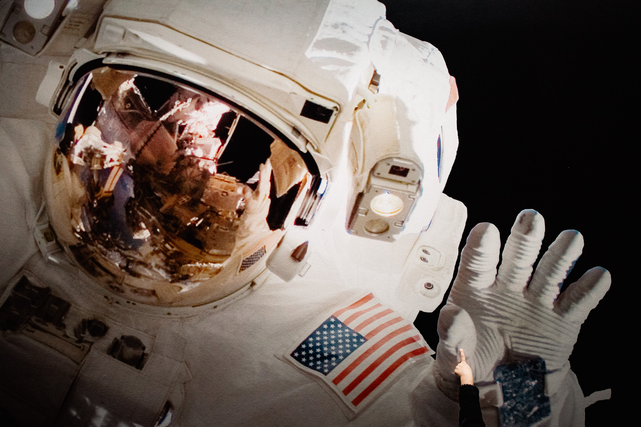 girl touches astronaut