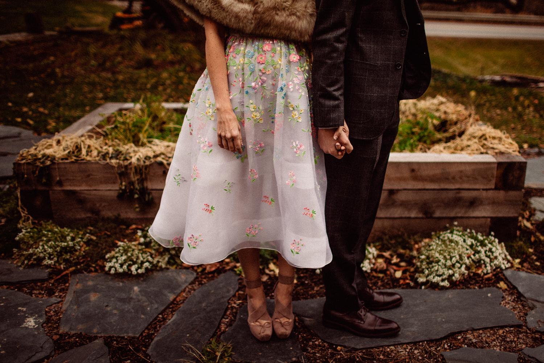 vermont wedding holding hands