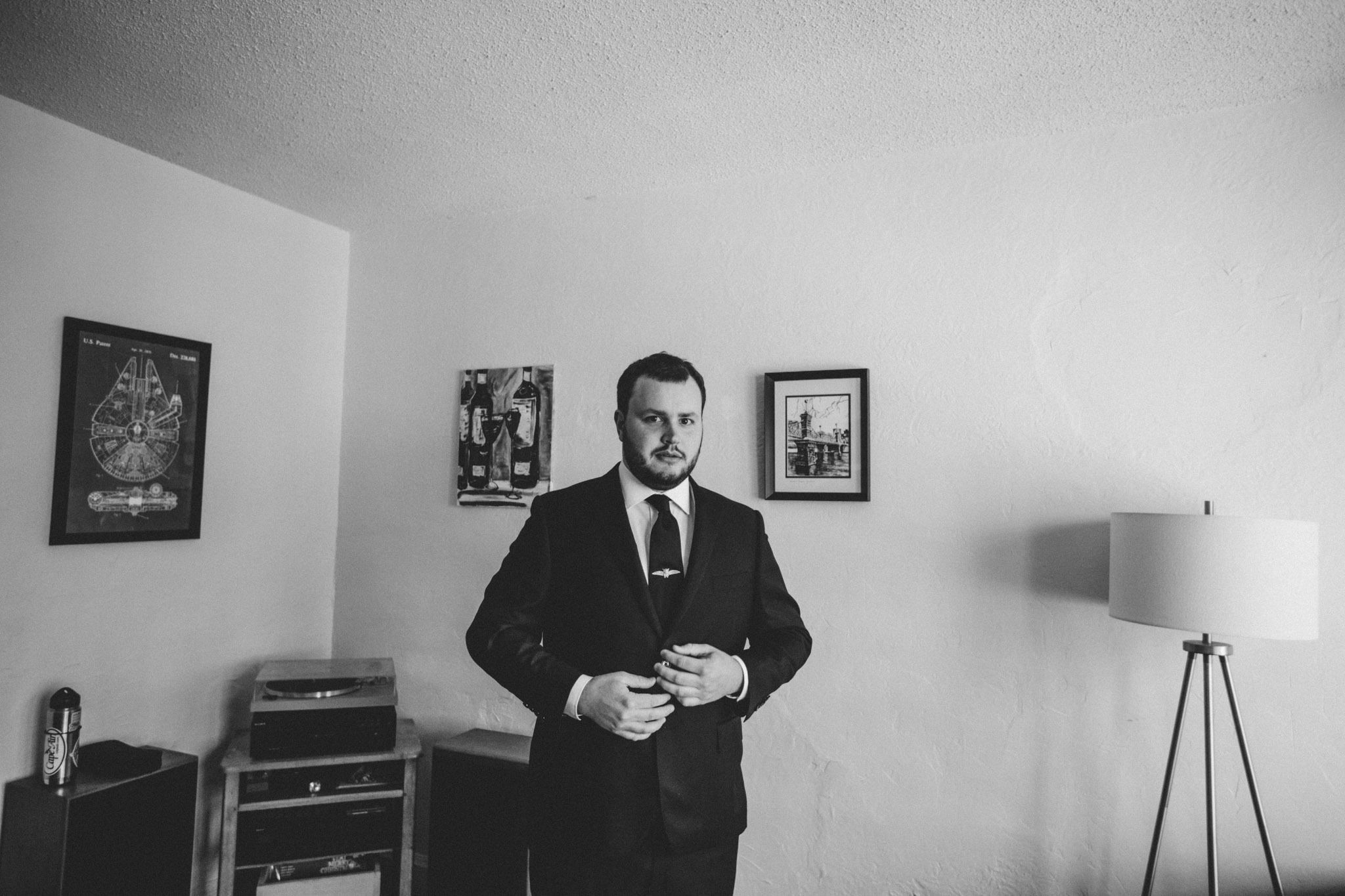 groom getting ready for elopement