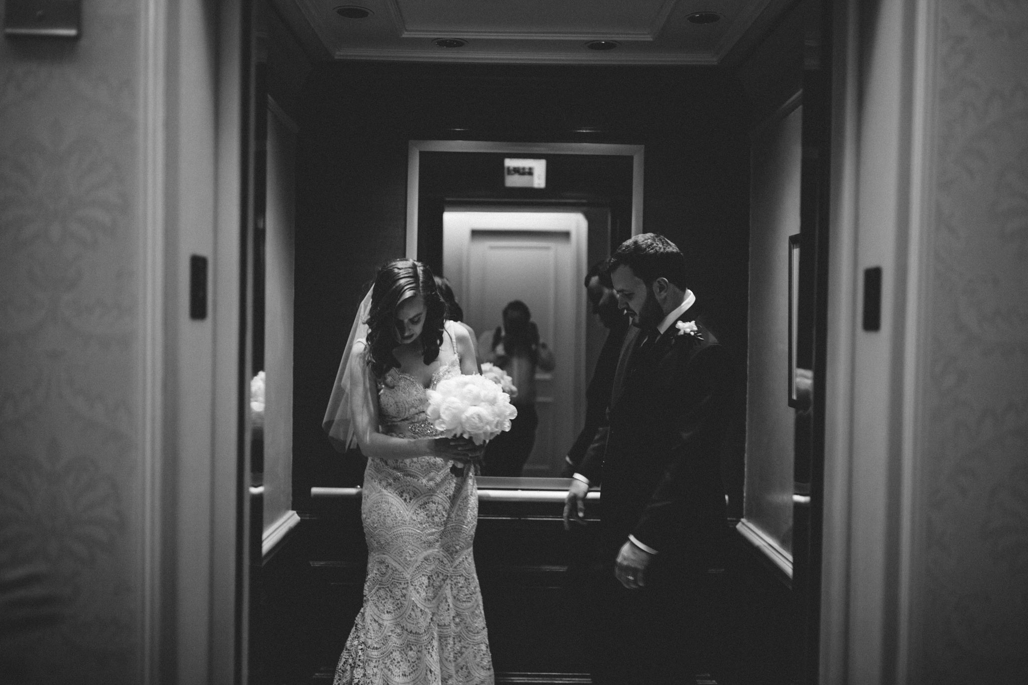 Bride and Groom in the elevator at the Langham