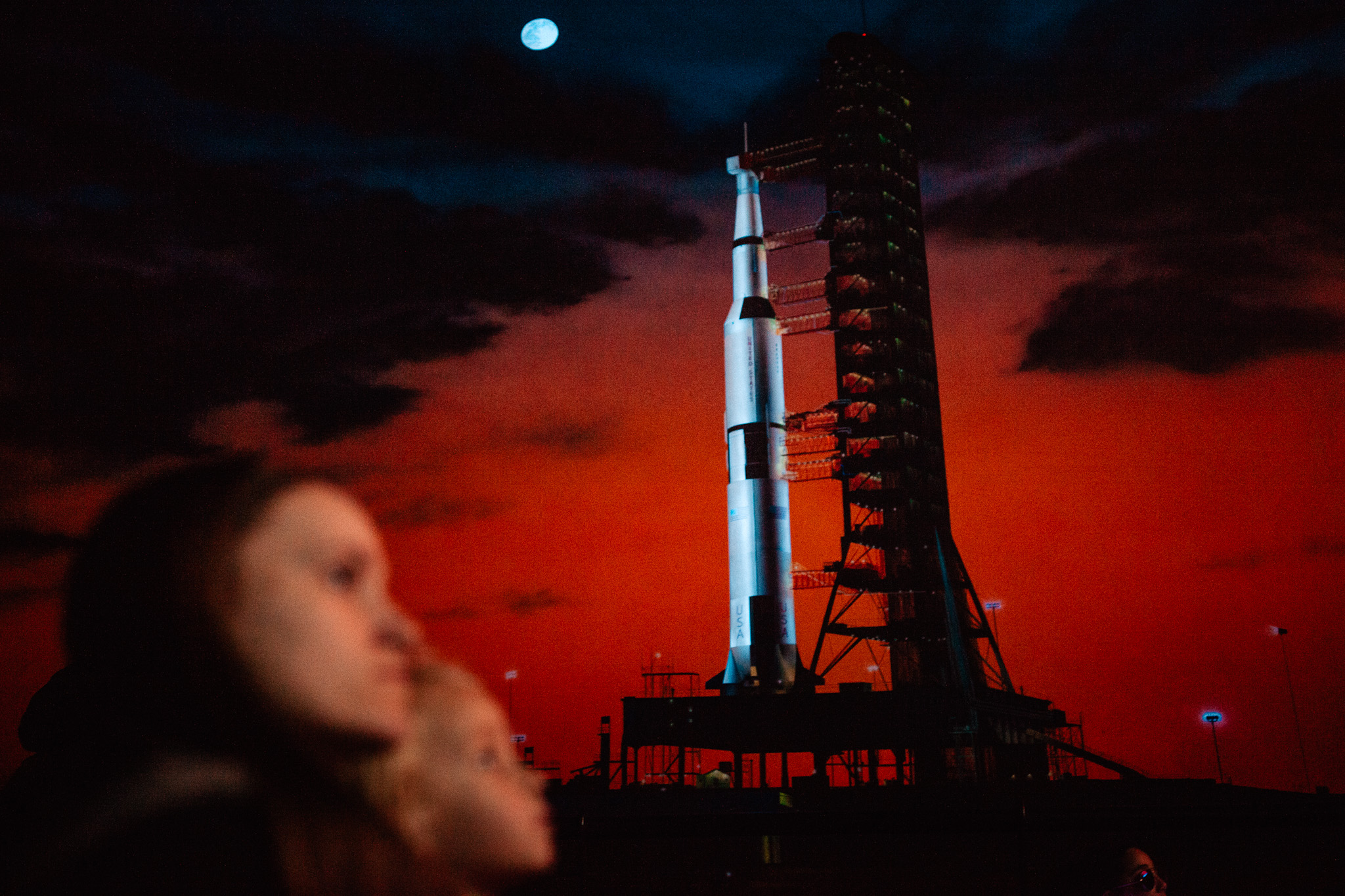 mother and daughter watch movie at kennedy space center