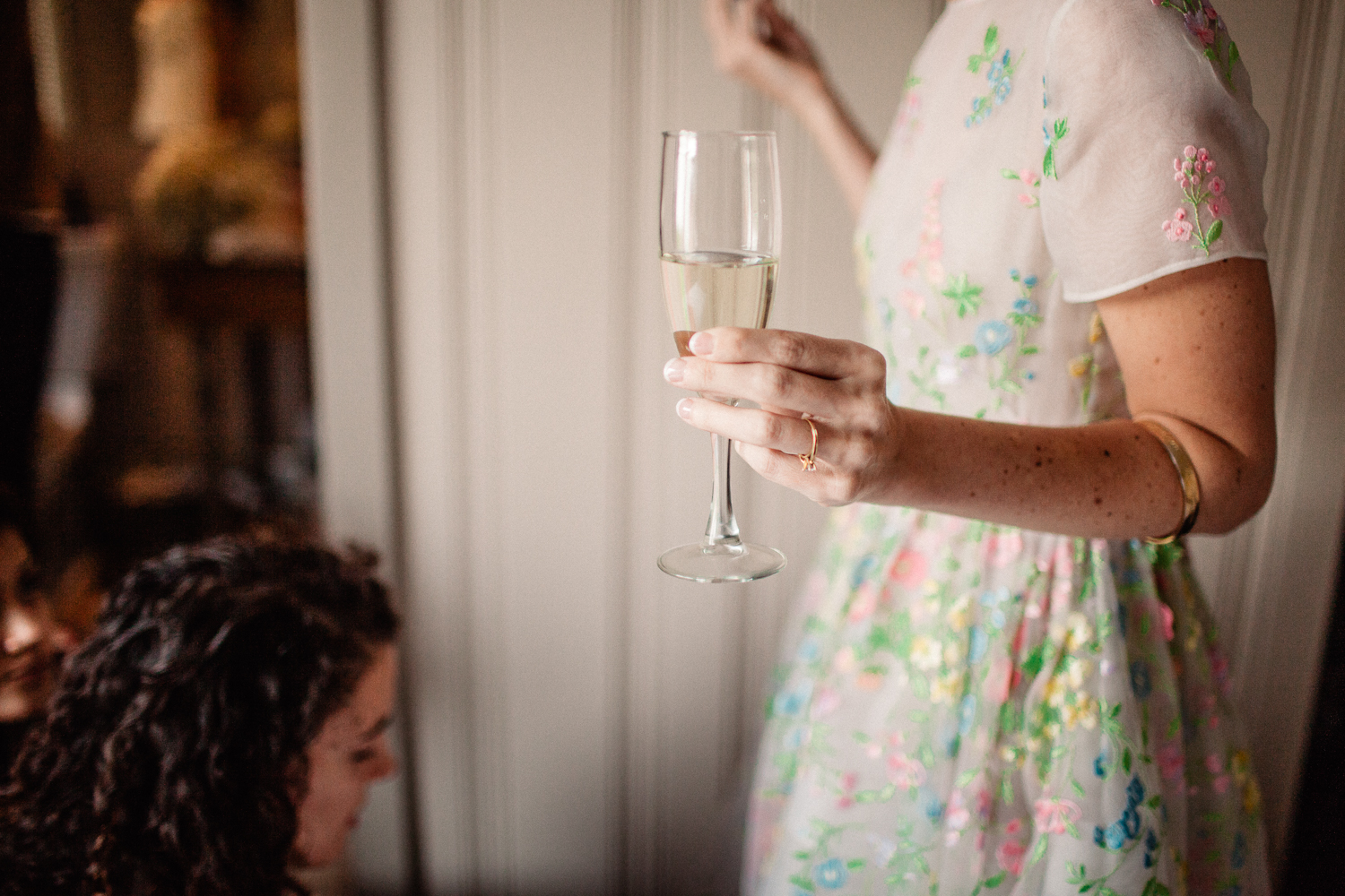 girl holding champagne glass on wedding day