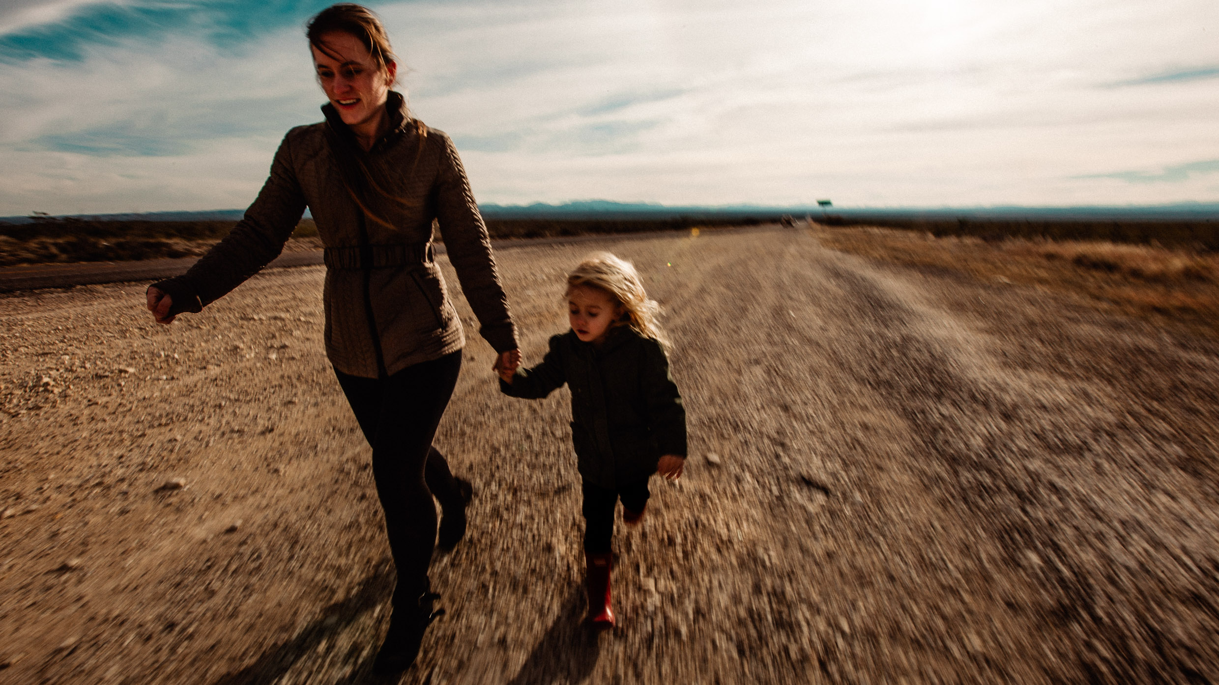 mother and daughter running in texas