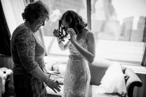 mother helps bride at boston elopement