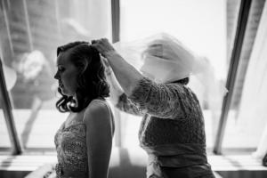 mother of bride helps with veil