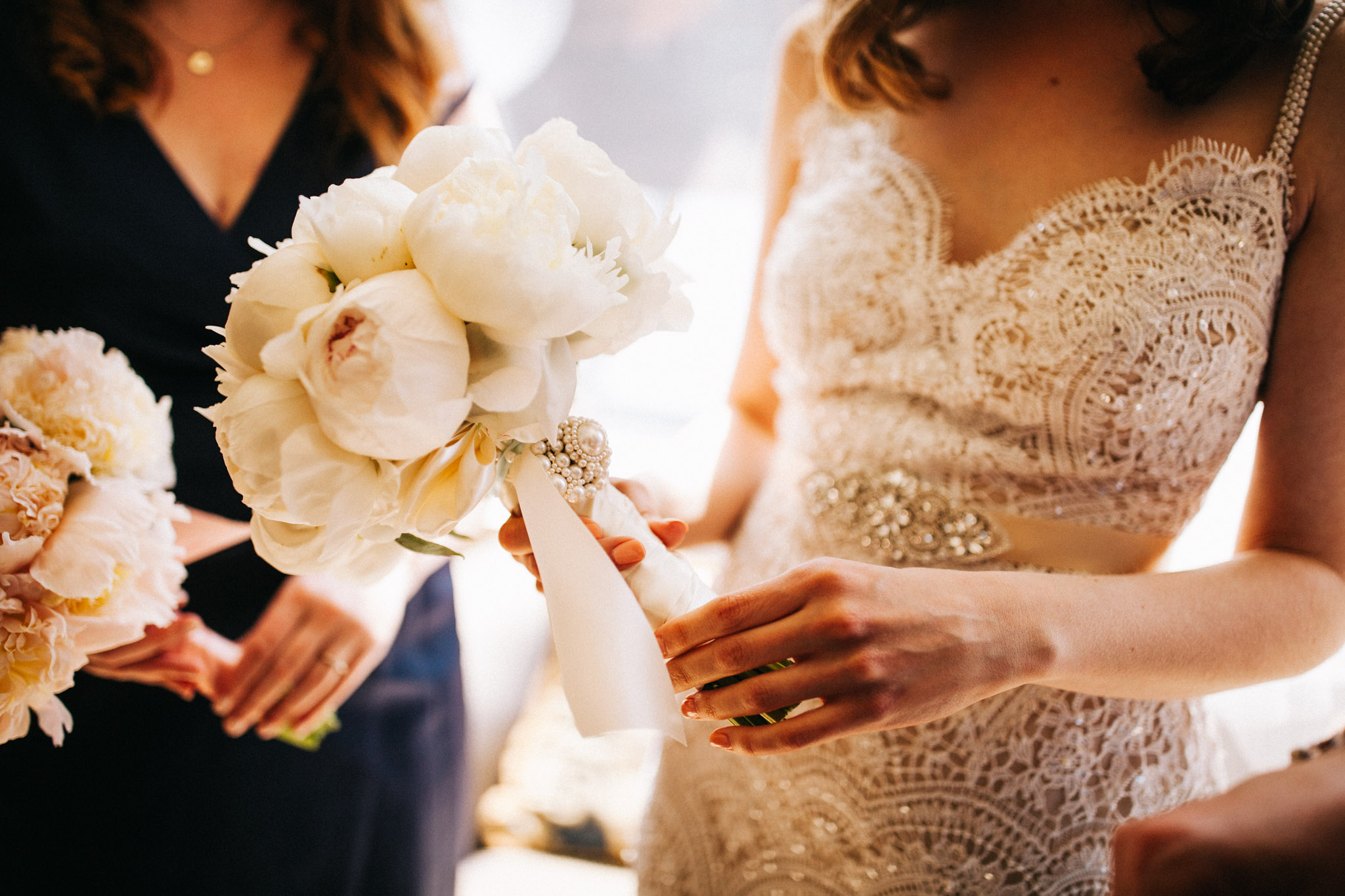 bride holds bouquet at Boston elopement