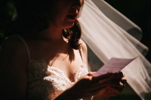 bride reads vows at elopement