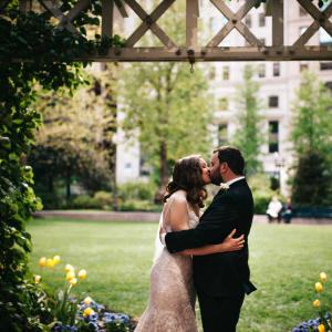 bride and groom first kiss in boston