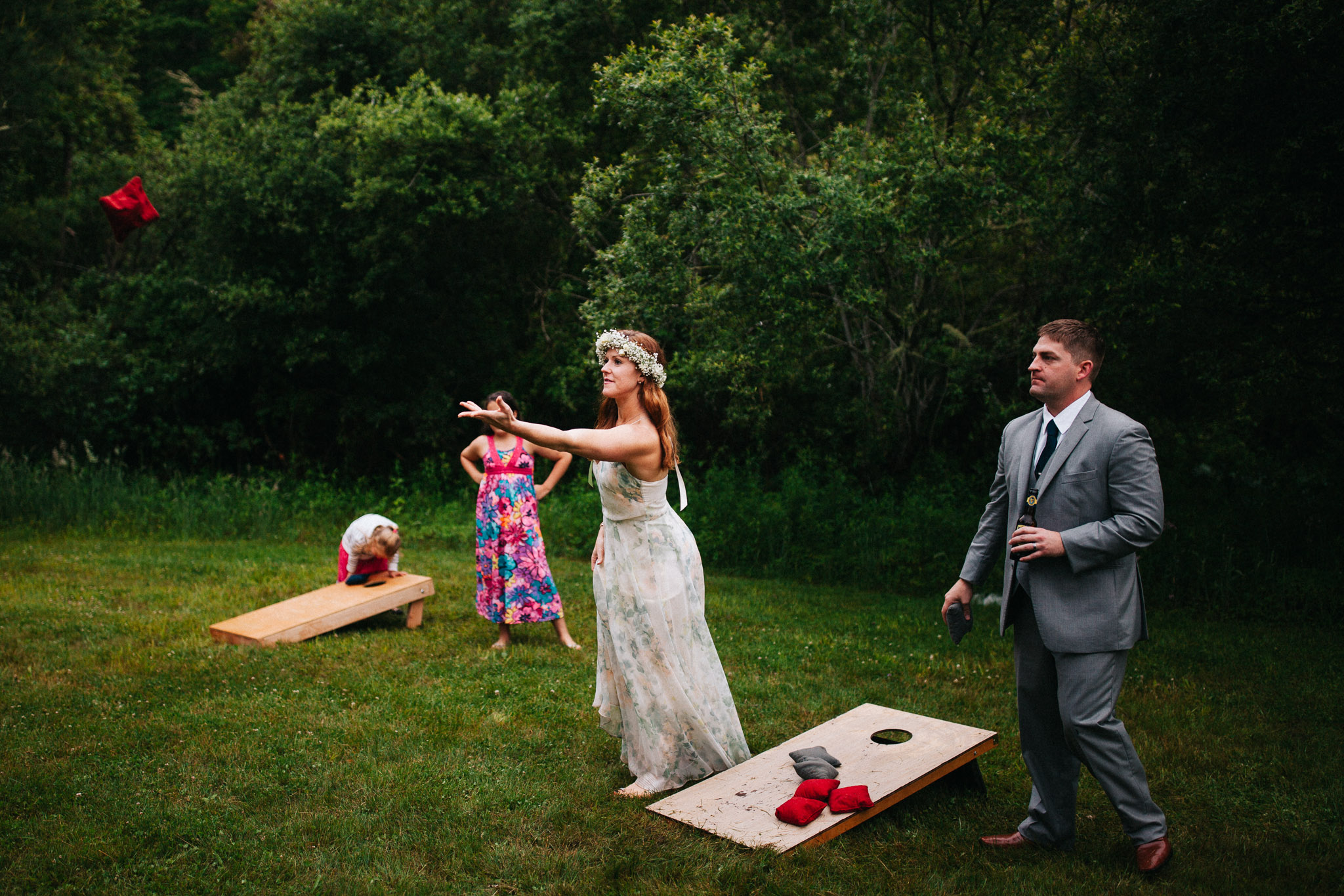cornhole with bride and groom
