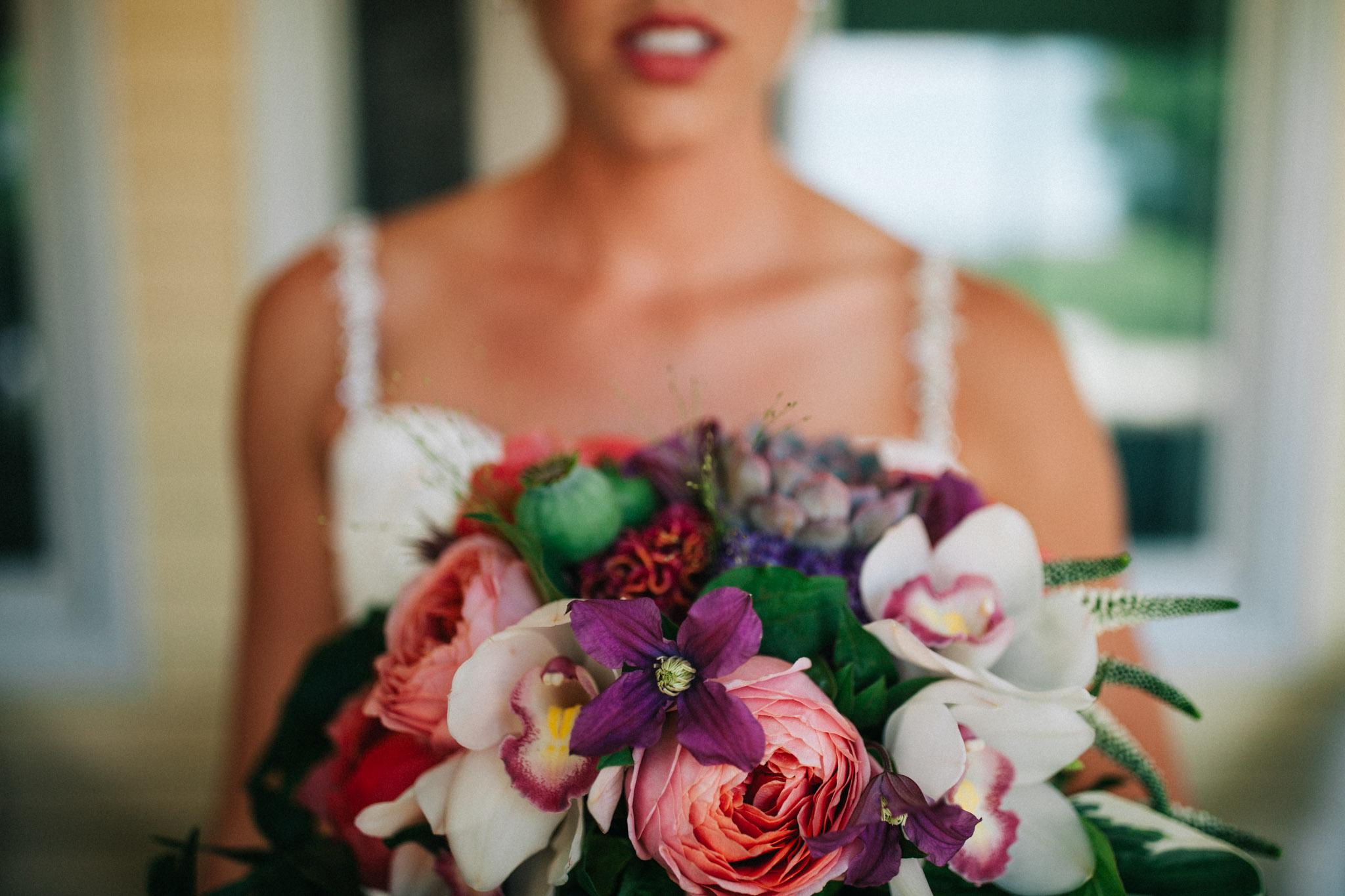 moody bride holding flowers